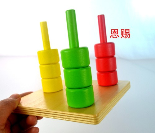 montessori material baby infant rings on pegs